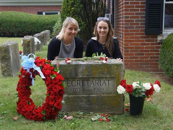 Holly Ross and her sister Laura visits Secretariat's grave at Claiborne Farm