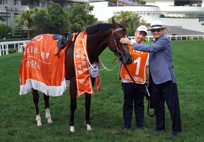 Beauty Generation with trainer John Moore and his strapper after he distanced his rivals in the Gr.1 Champions Mile (1600m) - HKJC