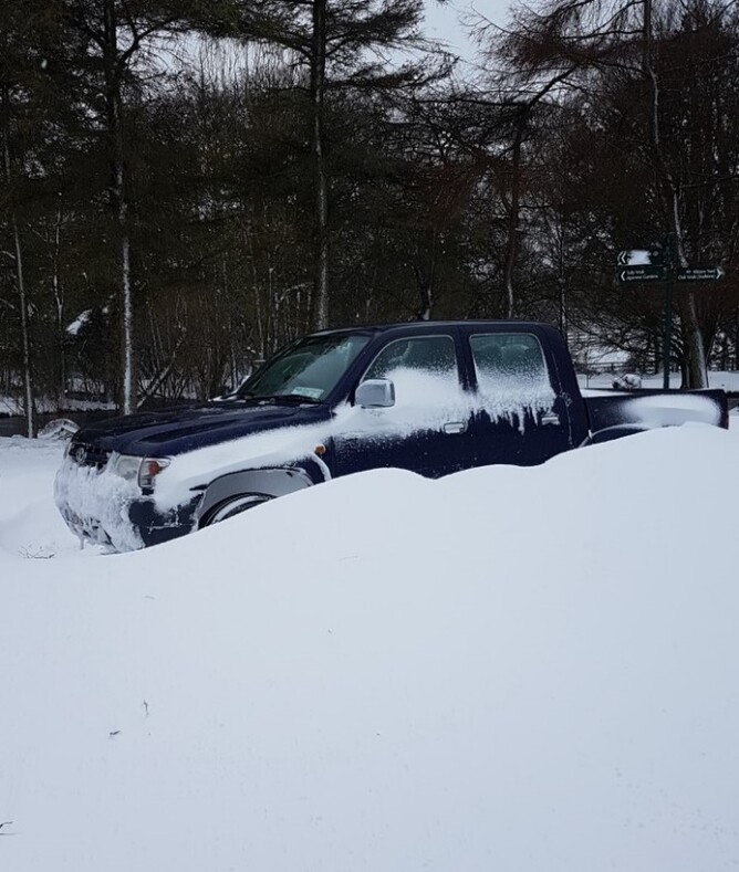 The farm ute buried in the snow