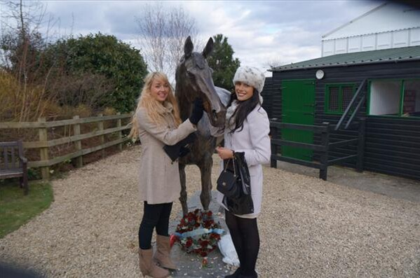 Holly and her Aussie flatmate Kara (pictured above) with a statue of jumps legend and three times Cheltenham Gold Cup winner Best Mate.