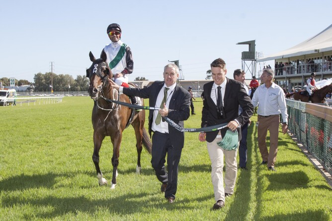 Sean Kiernan gives a thumbs up as he leads Fanatic and rider Michael Walker back to scale with son Jack  - Atkins Photography