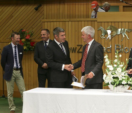 Nathan Guy and Ivan Bridge sign the biosecurity agreement at the Karaka Yearling Sales on Monday