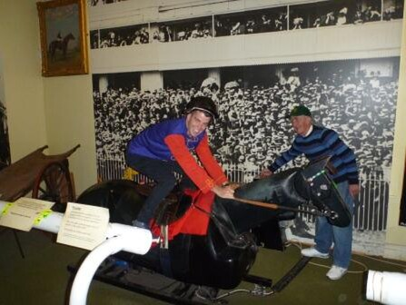 Jamie tries out The Queen's silks at the the Horse Racing Museum
