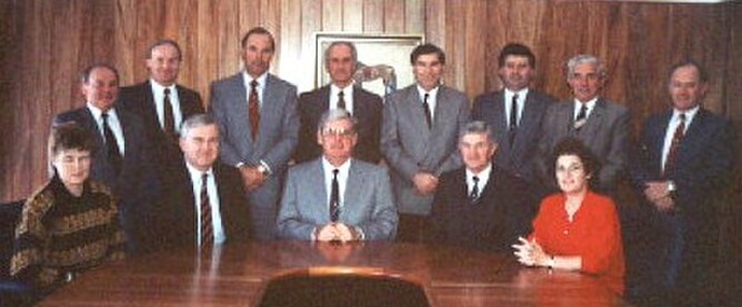 President Ross Finlayson (centre) photographed in 1990 with the Council and Executive staff in the Boardroom of the newly opened NZTBA office building at Ellerslie Racecourse.