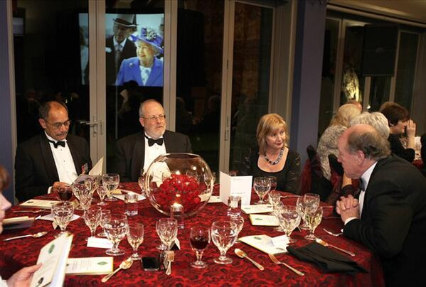 An image of Her Majesty The Queen at Royal Ascot is reflected in the window behind His Excellency, the Governor General, Lt. Gen. the Rt. Hon. Sir Jerry Mateparae (left), NZTBA President Peter Francis, Her Excellency Lady Janine Mateparae and former NZTBA President John Aubrey. - PHOTO: Trish Dunell